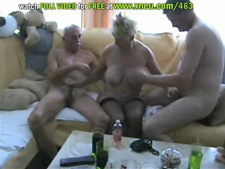 golden-haired granny in nylons has a threesome